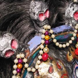 "Mahakala (silver) - detail, acrylic on paper maché, hand beaded ornaments, horsehair, 14""x16""x4"""