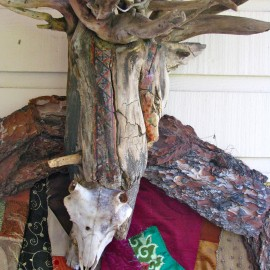"Lord of Divinity - detail (2010), tree bark, tree root, fabric installation, sheep skull, fabric transfer, 34""x55""x17"""