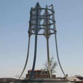 Tulga Public Sculpture (2009) (Ulaanbaatar Park, Denver, CO), stainless steel with cement engraved base, 20 ft x 7'6""