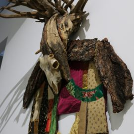 "Lord of Divinity (2010), tree bark, tree root, fabric installation, sheep skull, fabric transfer, 34""x55""x17"""