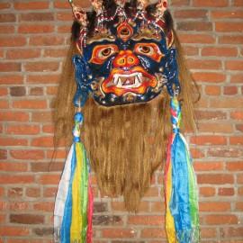 "Mahakala - full view, acrylic on paper maché, hand beaded ornaments, horsehair, khadag (various colored silk) 35""x39""x9"""