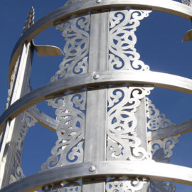 """Tulga Public Sculpture - detail (2009) (Ulaanbaatar Park, Denver, CO), stainless steel with cement engraved base, 20 ft x 7'6"""""""