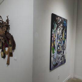 "Lord of Divinity - detail (2010), tree bark, tree root, fabric installation, sheep skull, fabric transfer, 34""x55""x17"""
